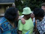Mrs. Shirley (center) is greeted at her surprise birthday party.