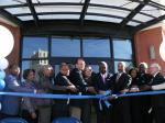 University leaders, city leaders, and investors participate in the ribbon cutting ceremony for One University Place