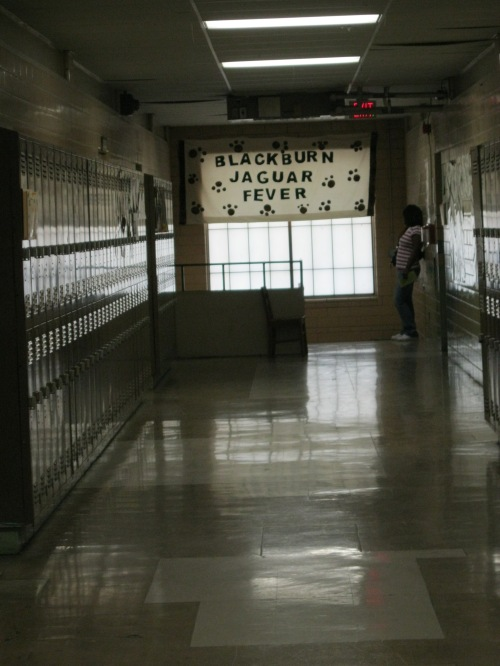 "Upstairs hallway with ""Blackburn Jaguar Fever"" banner"